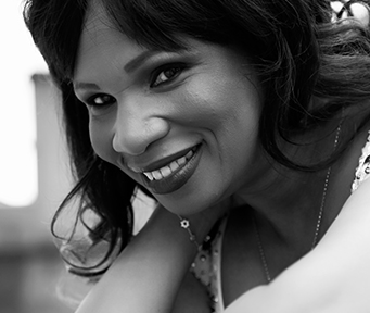 Black and white photo of Marcia Harewood smiling
